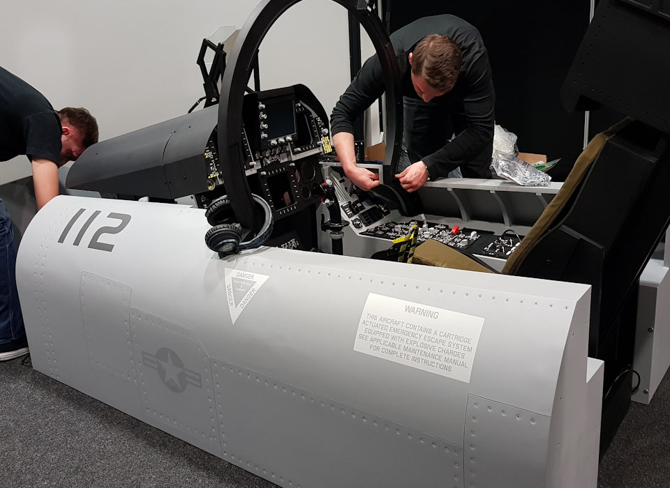F-18 cockpit simulator with fuselage delivery